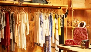 Rows of stylish clothes, beachwear & accessories in the Hippie Chic Hotel Boutique Shop in Mykonos