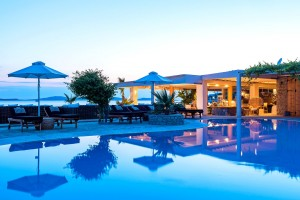 Dusk at the sea view Hippie Chic Hotel outdoor swimming pool in Agios Ioannis, Mykonos