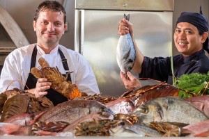 Chefs at one of the Hippie Chic Hotel restaurants show off fresh fish & seafood