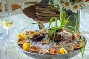 Hippie Fish restaurant serves dishes like mixed seafood platter with sea urchins, cockles & Tabasco