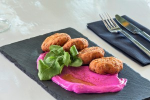 Stylishly presented patties with purée at Hippie Fish dining restaurant at Hippie Chic Hotel Mykonos
