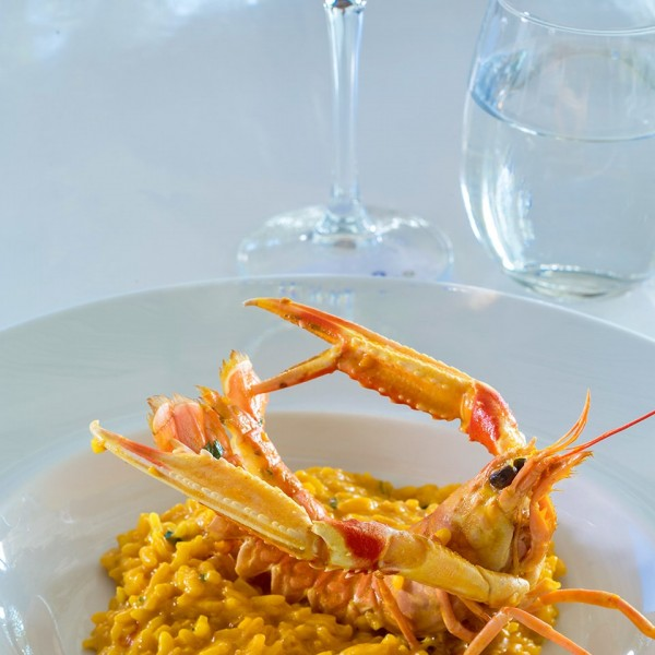 Lobster seafood risotto & rose wine at Hippie Fish dining restaurant at Hippie Chic Hotel in Mykonos