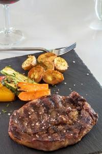 Hippie Fish Mykonos restaurant dish of beef steak with potatoes & vegetables at Hippie Chic Hotel