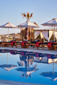 The Hippie Chic Hotel Mykonos pool has luxury sunbeds, umbrellas & cabanas for relaxing & sunbathing