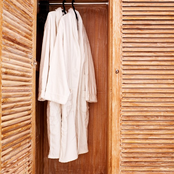 Hotel fluffy white robe & slippers inside a wardrobe at the Hippie Chic luxury Hotel in Mykonos