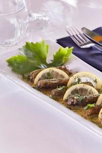 Hippie Chic Hotel restaurant traditional Greek cuisine dish of dolmadakia stuffed vine leaves
