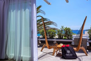 Balcony chairs & a Hippie Chic Hotel bag on private sea view veranda of Hippie Chic Suite in Mykonos