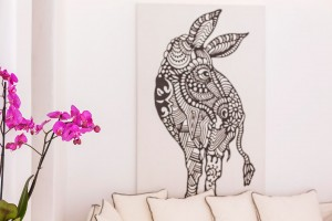 Stylish donkey artwork above sofa in the whitewashed Classic Room at Hippie Chic Hotel in Mykonos