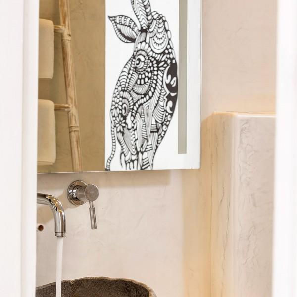 Basin, mirror & Apivita toiletries in the bathroom of the Hippie Chic Hotel Classic Room in Mykonos