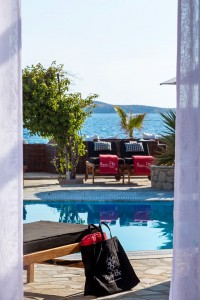 View of the Hotel swimming pool & the sea from the veranda doors of the Hippie Chic Suite in Mykonos