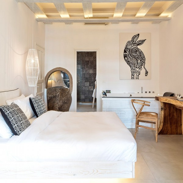 Indoor Jacuzzi, king size bed, desk, chair & TV in the luxury Junior Suite with Sea View in Mykonos