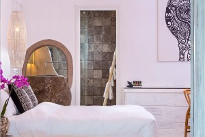 Hippie Chic Hotel Junior Suite with Sea View features a king size bed & stylish decor & accessories