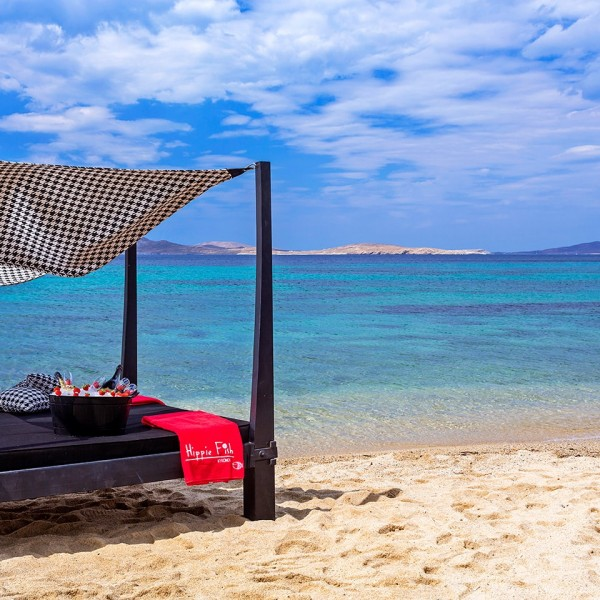 Guests can enjoy drinks & sunbathing on a cabana on Hippie Chic Hotel beach with a view of the sea