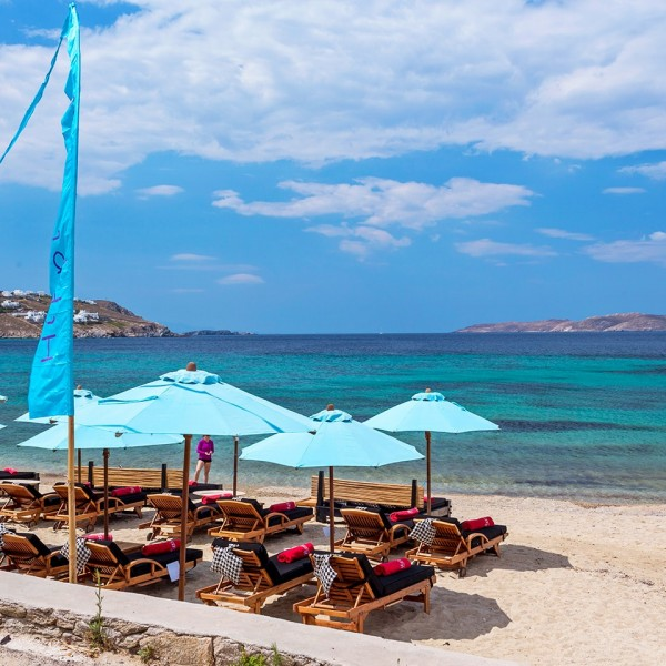 Rows of sunbeds, sunchairs & umbrellas on Agios Ioannis beach in front of Hippie Chic Mykonos Hotel
