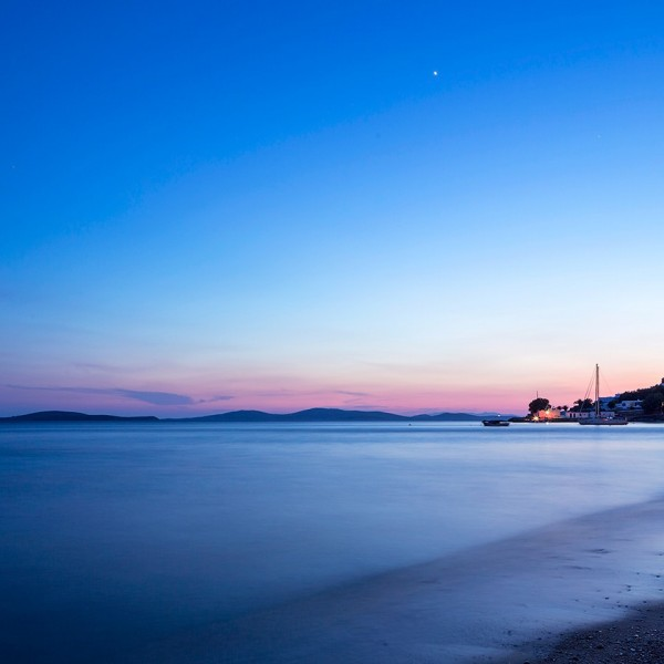 A beautiful view of the Mykonos sunset from the Agios Ioannis Hotel beach by Hippie Chic Hotel