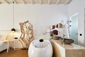Indoor Jacuzzi & washbasins in luxury bedroom of Hippie Chic Hotel Suite in Agios Ioannis, Mykonos