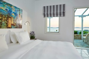 King size bed in Hippie Chic Hotel Superior Room located beside the private veranda with a sea view