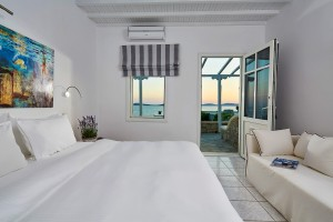 Hippie Chic Hotel Superior Room with Sea View in Mykonos with a bed & sofa, & large private veranda