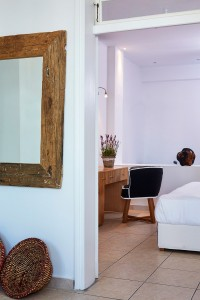 A doorway to the light & airy bedroom of the Hippie Chic Hotel Junior Suite with Sea View in Mykonos