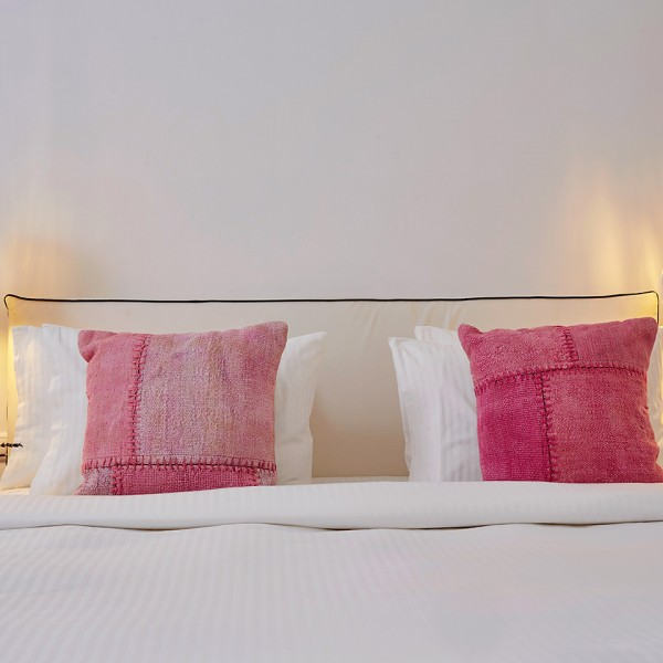 Comfortable king size bed & pillows in the Hippie Chic Hotel Junior Suite with Sea View in Mykonos