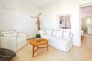 Sofa, chair & coffee table in the living room area of the Hippie Chic Hotel Deluxe Room in Mykonos