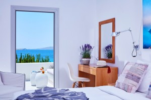 Bedroom in Superior Room with Sea View in Mykonos, featuring king size bed, desk, mirror & veranda