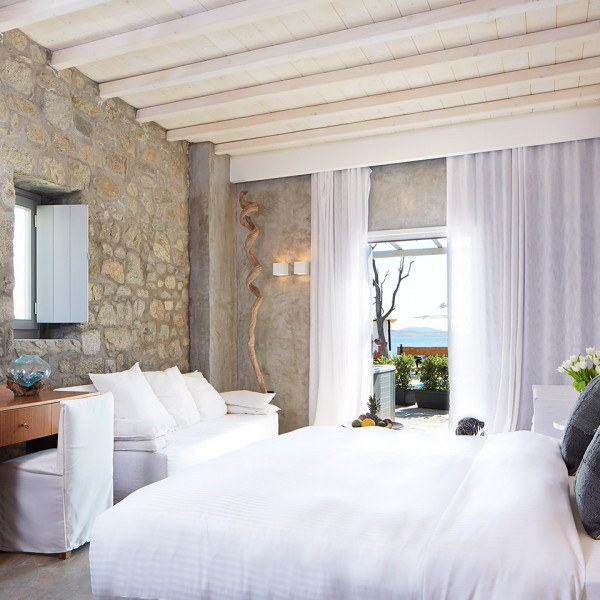 Bed, TV, sideboard & sofa in the Hippie Chic Hotel Euphoria Exclusive Suite with sea view in Mykonos