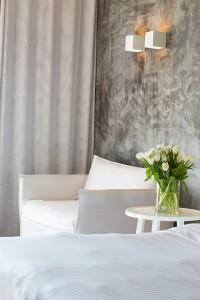 Chair & bed in luxury Euphoria Exclusive Suite on the ground floor of Hippie Chic Hotel in Mykonos