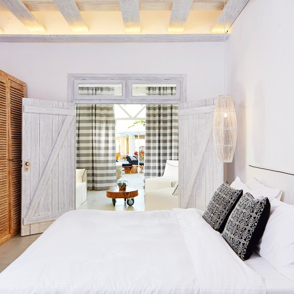 Rustic design style bedroom & living room of the spacious Hippie Chic Mykonos Hotel Junior Suite