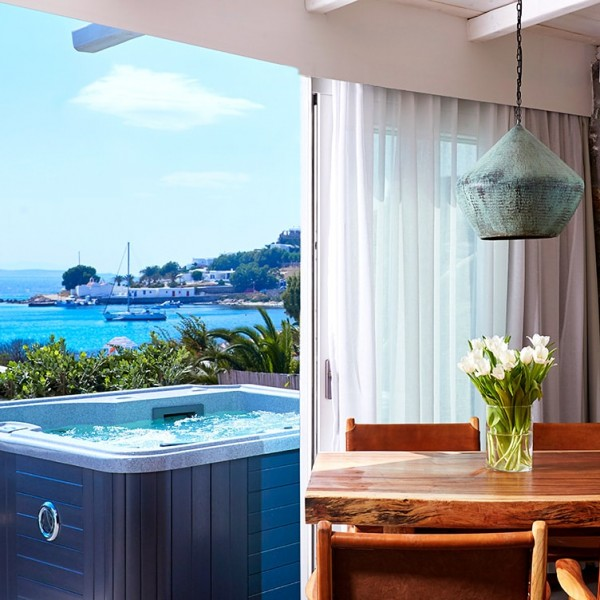 The luxury Hippie Chic Hotel Suite in Mykonos has its own Jacuzzi & private sea view veranda.